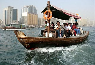 Abra (boat) crossing Dubai Creek